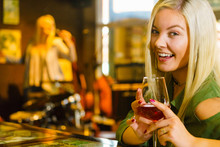 Girl With Alcohol Glass In Pub...