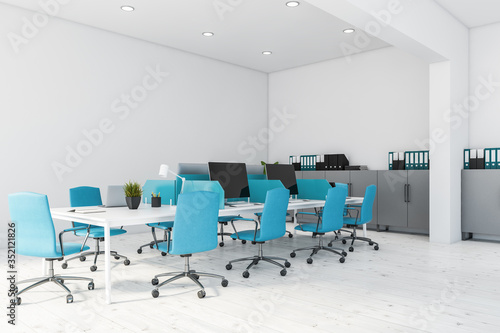 Obraz White and blue open space office corner - fototapety do salonu