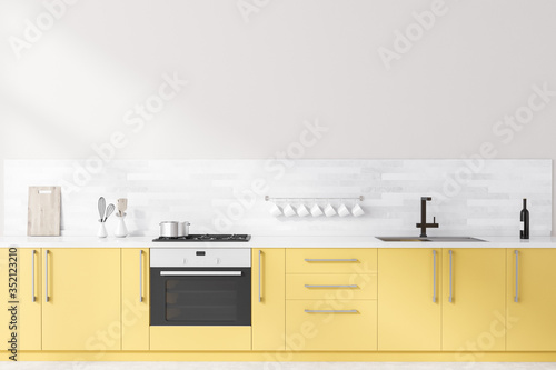 Obraz White kitchen with yellow countertops - fototapety do salonu