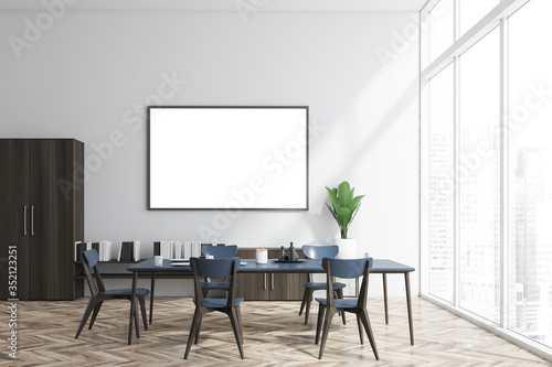 Obraz White and wood dining room, bookshelf and poster - fototapety do salonu