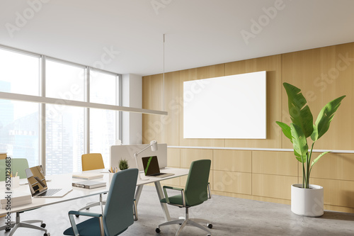 Obraz Wooden open space office corner with poster - fototapety do salonu