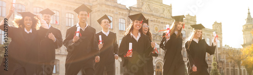 Happy students with diplomas near campus. Banner design Fototapeta