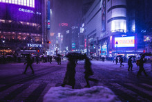 Crowd On Snow Covered Street A...