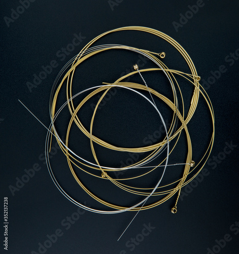 Vászonkép Electric guitar strings isolated on black background.