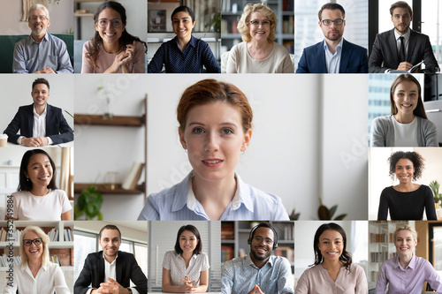 Obraz Headshot screen application view of multiracial businesspeople talk brainstorm on group video call, diverse colleagues have webcam conference, engaged in web team meeting or online briefing at home - fototapety do salonu