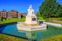 Statue Of Queen Victoria In Front Of Kensington Palace Inside Kensington Gardens In London, UK