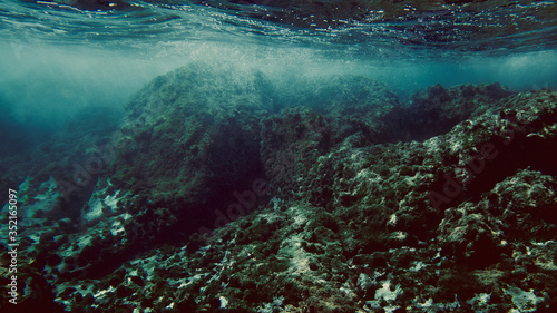 View underwater of waves breaking over rocks - 352165097