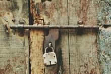 Close-up Of Locked Wooden Door
