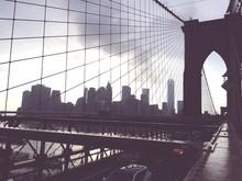 Silhouette Brooklyn Bridge Against Sky