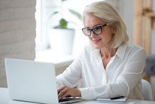 Focused Middle-aged Businesswo...