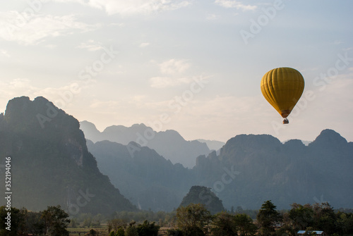 Canvastavla Low Angle View Of Hot Air Balloon Against Mountains And Sky