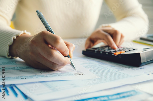 Fotografia Closeup woman filling form of Individual Income Tax Return,