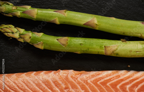 Canvas Print Salmon Fish Cooking Raw Fillet Pepper Salt Olive Oil Rosemary Lemon Green Aspara
