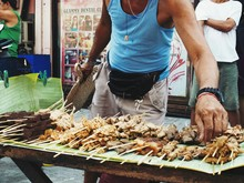 Man Selling Meal At Food Stall