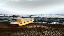 Lifeboat Moored At Sea Shore A...