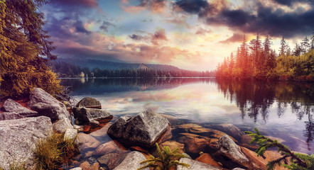 Fototapeta Rzeki i Jeziora Amazing lake Strbske Pleso during Sunrise. Creative image. Wonderful Autumn landscape. Picturesque view of nature. Amazing natural Background. Popular Travel Destinations. High Tatras. Slovakia