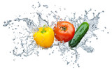 tomato, cucumber, pepper in spray of water
