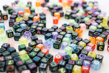 Colorful Alphabets Beads On Wh...