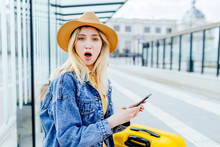 Portrait Of Beautiful Girl In Staw Hat, Jeans Jacket Waiting At The Bus Stop.
