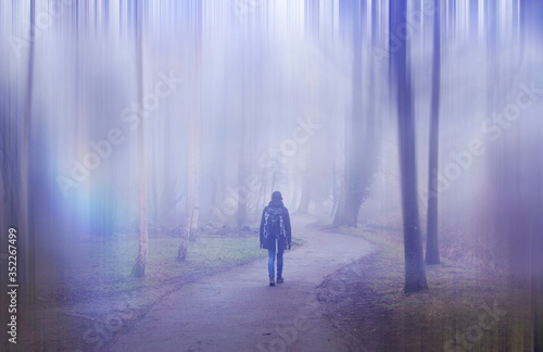 Woman walking in a surreal forest Canvas Print