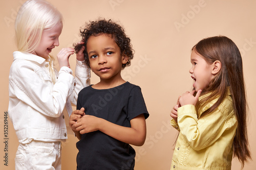 Photo portrait of beautiful kids with natural unusual appearance