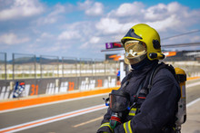 Firefighter Watching On Race T...