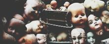 Full Frame Shot Of Abandoned Dolls