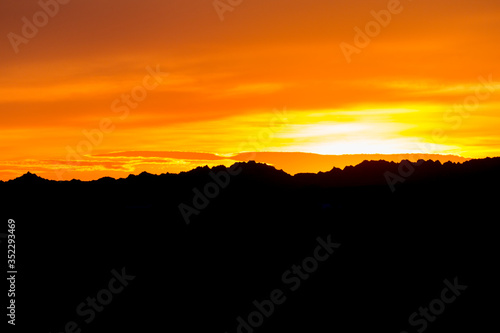 Landscape view of a colorful sunset in Badlands National Park in South Dakota).