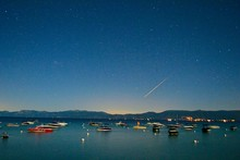 Boats Moored On Lake Against C...