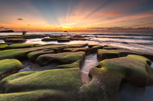 Boulders Of Rock Covered By Moss At Beach During Sunset In Kudat