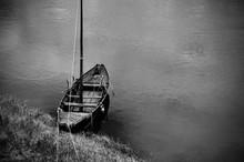 Sailboat Moored To Shore
