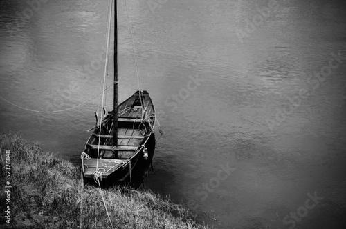 Valokuvatapetti Sailboat Moored To Shore