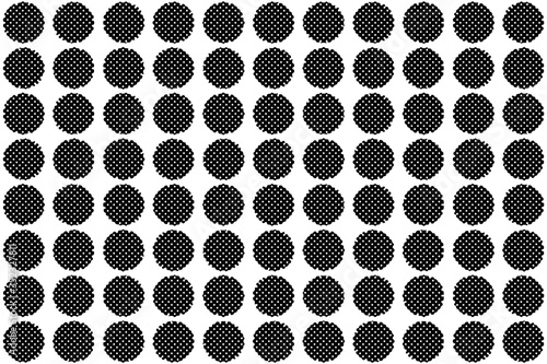 An abstract black and white halftone dot pattern.