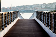 Footbridge Against City