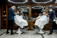 Family At Barbershop. Young Fa...