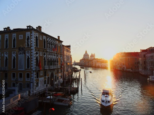 Fototapeta Grand Canal Amidst Buildings Against Sky During Sunset