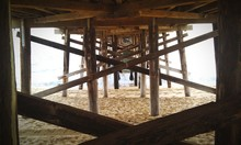 Underneath View Of Pier On Beach