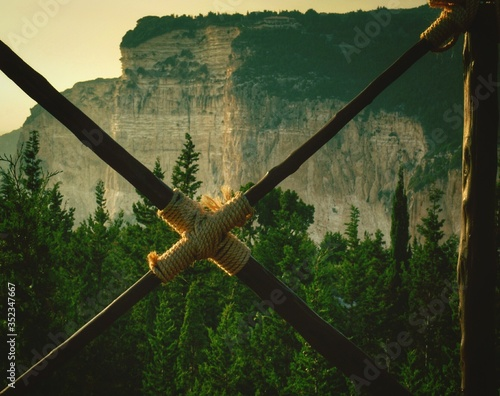 Photographie Cross Shape Bamboos Against Rocky Mountain