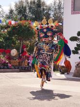 Black Mask Dancer During Tibetan Losar Celebration