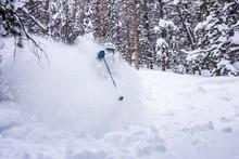 Man Skiing On Ski Slope