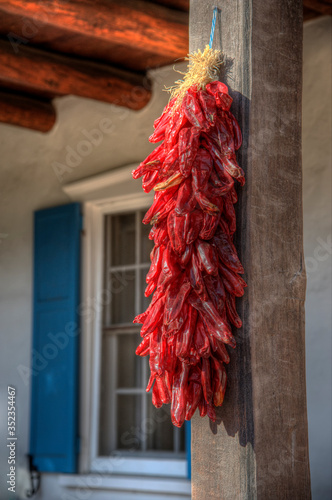Red Chile Ristra String Hanging in Front of Blue Shutters
