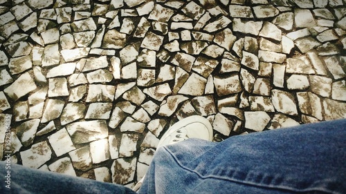 Fotografia Low Section Of Man On Paving Stones
