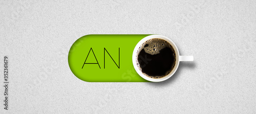 cup of coffee and German text for ON on bright paper background Canvas Print