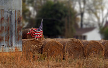 Weathered American Flag On Hay...