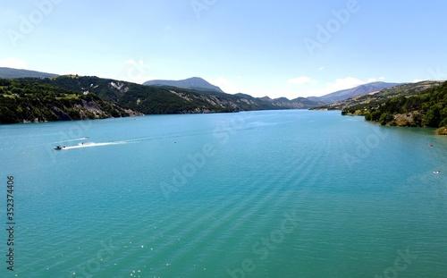 Scenic View Of Lake Barrage De Serre-poncon Against Sky Canvas Print