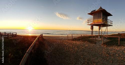 Fotografiet Lifeguard Hut On Beach Against Sky