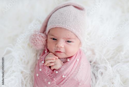 Cute awake newborn in knitted hat Canvas Print