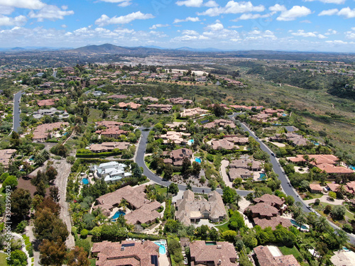 Aerial view of high class neighborhood with big residential mansions with swimming pool in the green valley, Pacific Highlands Ranch, San Diego, California, USA Wallpaper Mural