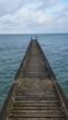 Wooden Pier Over Calm Sea Against Sky