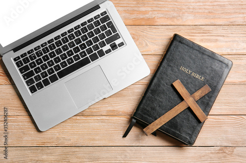 Fotografie, Tablou Holy Bible, laptop and cross on wooden background